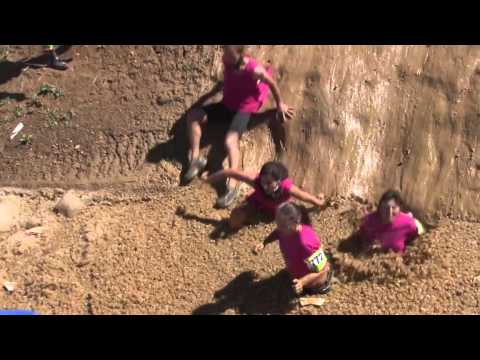DelawareonlineTV - Delaware Mud Run participants slide into an ice-filled pit during the fourth running of the event, which benefits the Leukemia Research Foundation of Delaware.