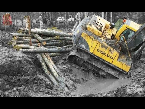 (shit - At Håkanbo North Lingbo in Sweden a excavator is stuck in the mud. With a Scania 970 from 1962 and a Heavy wrecker from Thorson´s i Uppsala, Terribärgarn hel...