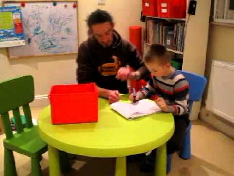 ABA Work at home &#8211; E working on writing skills.MOV