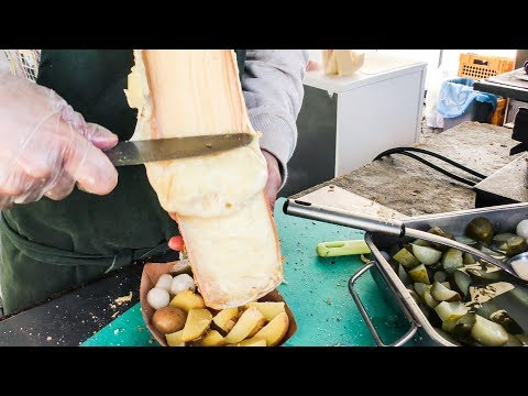 Swiss Raclette. Huge Melted Cheese Tasted In Prague. Street Food Of The Czech Republic