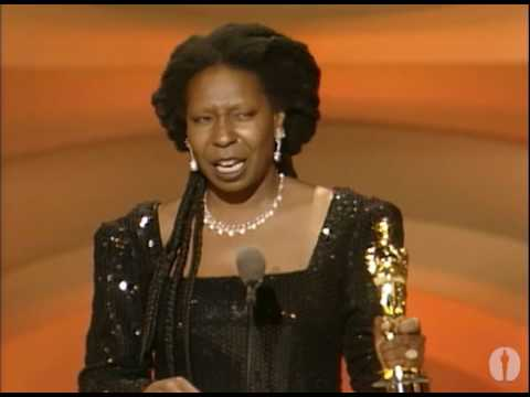 whoopi - Denzel Washington presenting Whoopi Goldberg with the Oscar® for Best Supporting Actress for her performance in