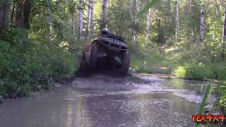 2. 500 arctic cat in the mud with 29.5 swamp lites on custom rims