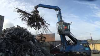 Terex Fuchs MHL 331 material handler and MHL 320 material handler processing scrap metal at Southwark Metals