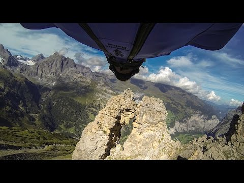Wingsuit Flight Through a Tiny TwoMeter Opening Between Rock