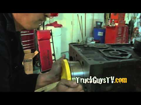 TruckGuysTV - How To Install Cylinder Packs for a Caterpillar 3406 Engine.