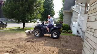 8. Kawasaki brute force 650 in action plowing dirt