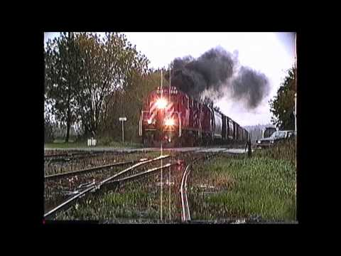 RS18 - CP Rail action filmed by Richard 'Moose' Ouellette between Newport and Richford, VT. on 10/06/1989. Great stuff...Three C424's on a train...Two RS18's on ano...
