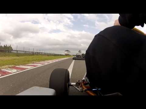 Electric go kart playing with petrol powered go kart