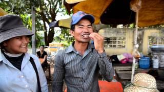 Man Eats Fried Tarantula Spider In Skuon, Cambodia