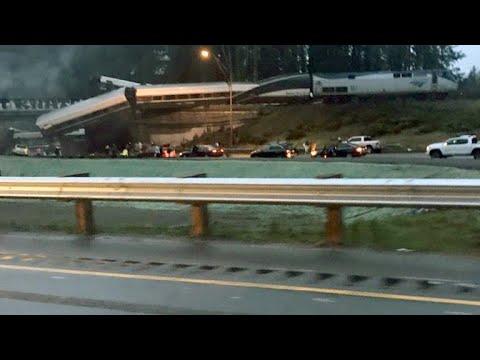 Amtrak train derails, dangles over interstate in Washington