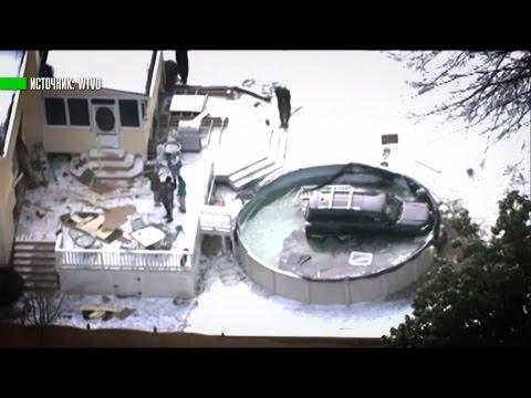 Американец въехал на внедорожнике в замёрзший бассейн (видео)