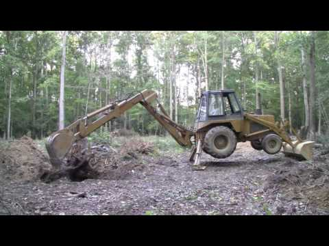 Case 580C Backhoe - Digging out three big stumps - Part 1 (HD)