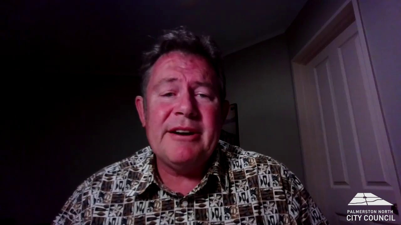 YouTube placeholder image shows still from video of mayor talking to camera from his study at home.