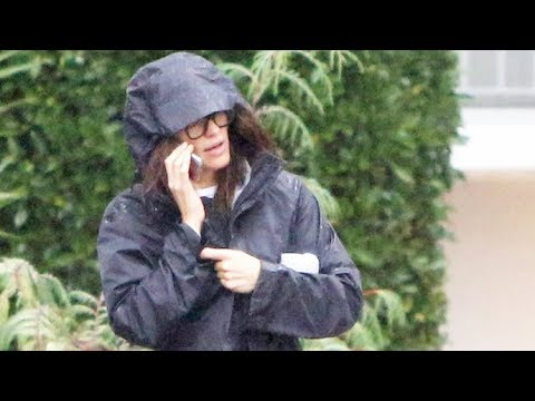 Jennifer Garner Tries To Keep Warm While Caught In A Nasty Downpour