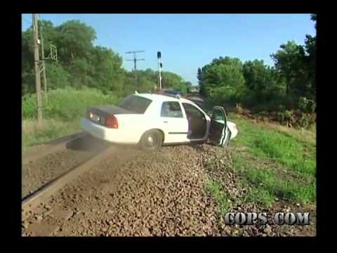 Cop gets stuck on train tracks in effort to chase bike