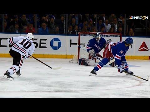 Video: Patrick Sharp nails the bullseye over shoulder of Henrik Lundqvist