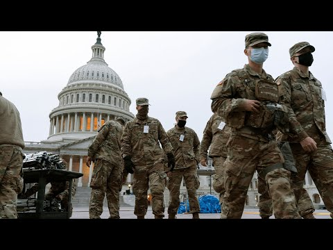 Troops pour into Washington DC as capital braces for unrest ahead of Joe Biden's inauguration