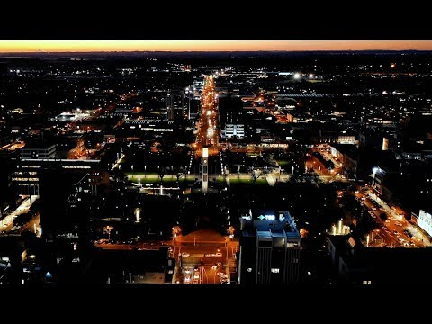 YouTube placeholder image shows Palmerston North central business district at night.