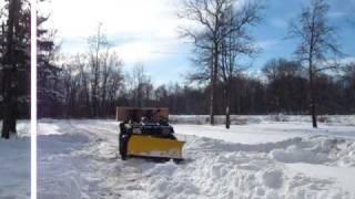 9. 2002 Arctic Cat 300 4x4 plowing foot of snow