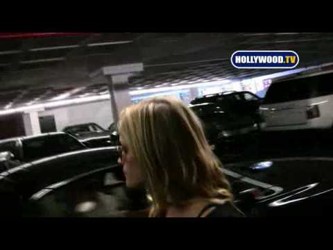 Reese Witherspoon Swarmed by Paparazzi at Airport