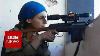 A Kurdish YPJ (Women's Protection Unit) sniper was filmed reacting after a bullet fired by an Islamic State (IS) group opponent narrowly missed her head.