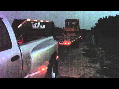 Gooseneck - The video quality is bad because of the lack of light. My brother came with a guy to haul his dozer right. I look down the road expecting a 18 wheeler, but t...