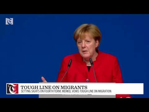 Angela Merkel vows tough line on migration