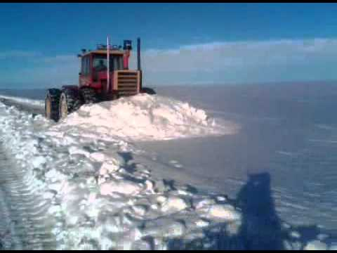 900 Versatile Tractor With Blade Plowing Snow