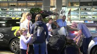Mrs Mirka Federer was left to pack the family's possessions onto a waiting trolley at Melbourne Airport Monday night as her ...