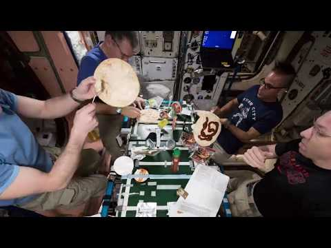 Astronauts eating pizza on the ISS