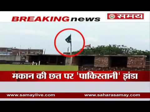 Pakistani flag on the roof of a house in Bihar