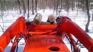 9. Kubota MX5100 hauling load of firewood on cold morning