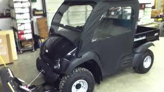 8. Custom 610 4x4 Mule w/plow, cab, heater and winch