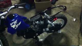 9. 2002 Yamaha PW50 checking for spark