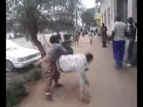 Wife Beats Up Irresponsible Husband, Africa-style (Slaps And Judo Moves)