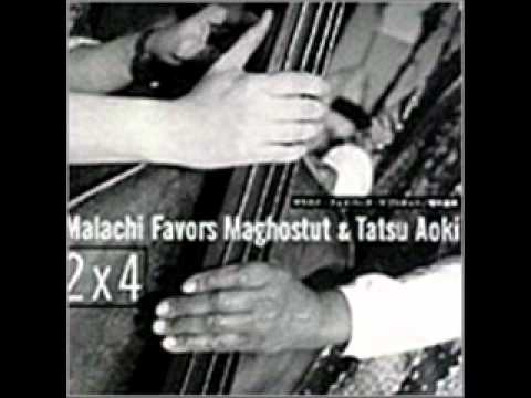 Malachi Favors Maghostut & Tatsu Aoki online metal music video by MALACHI FAVORS MAGHOSTUT