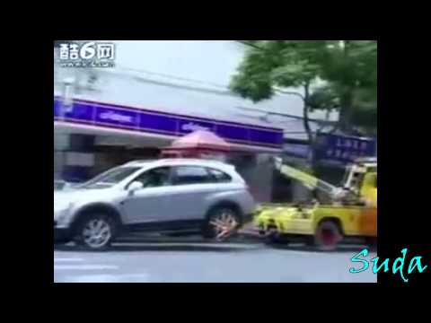 A lady angry that her car is going to get towed does something most probably wouldn't.