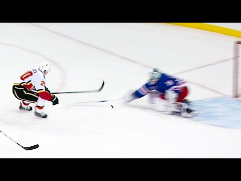 Video: Flames' Lazar pokes puck under Lundqvist to score first of the season