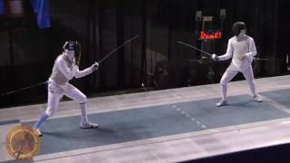 This is a semifinal bout in the men's foil event at the NCAA fencing championships in Indianapolis, Indiana. Maximilien Chastanet of Ohio State University is on the right and Nolen Scruggs of Columbia University is on the left.