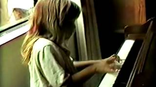 Fiona apple playing piano as a little child.