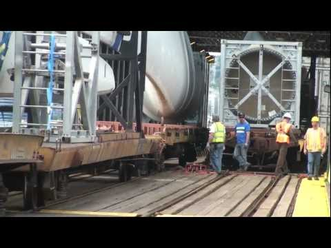 Railfan - Well folks, you are about to see something very rare in the world of railfanning. This video shows a windmill train being loaded on an Alaska-bound railbarge...