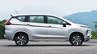 """The 4,475 mm long XPANDER blends stylish and roomy MPV lines with tough and dynamic SUV looks.    The distinctive """"Dynamic Shield"""" front design concept forms a continuum with the OUTLANDER PHEV, the PAJERO SPORT, and the ECLIPSE CROSS, and it is giving expression to the protection of passengers and pedestrians.    Wide flared fenders add to the powerful SUV-inspired looks.    The LED position lights are located high up in the engine hood side trim, not just for good looks, but also to make the car more noticeable. The headlights are placed low in the bumper, to maximize vision during rough road conditions.    The rear combination LED lights uniquely extend into the tailgate. The L-shaped LED tail lights are separate from the brake lights.    MMC's trademark horizontal dashboard architecture provides visual cues when navigating rough and windy roads.    The uncluttered instrument panel offers intuitive ergonomics, while the arched design expresses high quality and spaciousness as it visually flows into the front door trim panels.    The roof line tops a generous greenhouse. Thanks to a partially glazed-in rear pillar, the roof itself seems to float above the car. Subtle hints of tailfins in the rear side panels add to the XPANDER's bold looks.Xpanded comfortThe 7-seater XPANDER is wider outside (1750 mm) and larger inside than competitors in this class, for a different take on the MPV concept.     The roomy cabin space – largest in its segment – and the clever occupant layout of the XPANDER are complemented by generous luggage space. Accommodating passenger quarters, and generous headroom are offered to all passengers. There is excellent access to the comfortable third-row seats.    The backrests in the second row (60:40 split) and third row (50:50 split) can easily be folded down to arrange the seats and luggage in various combinations, or to create a large flat storage area without bumps, or gaps.    Also, the center backrest of the second row can be folded down to"""