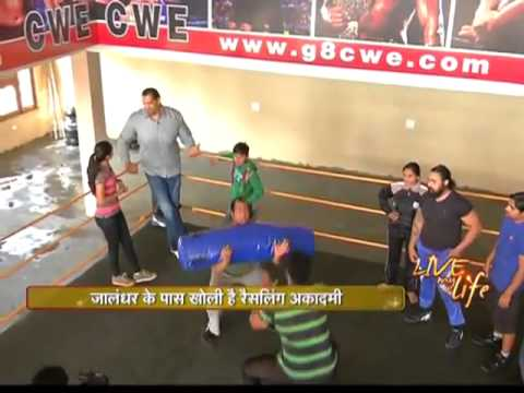 Khali teaches wrestling tips in his academy