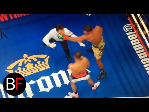 Boxing referee gets punched after the round! (видео)