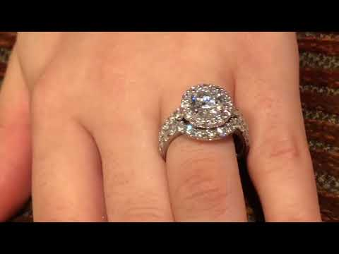 Platinum and Cubic Zirconia round 2 carat cubic zirconia halo style ring with band