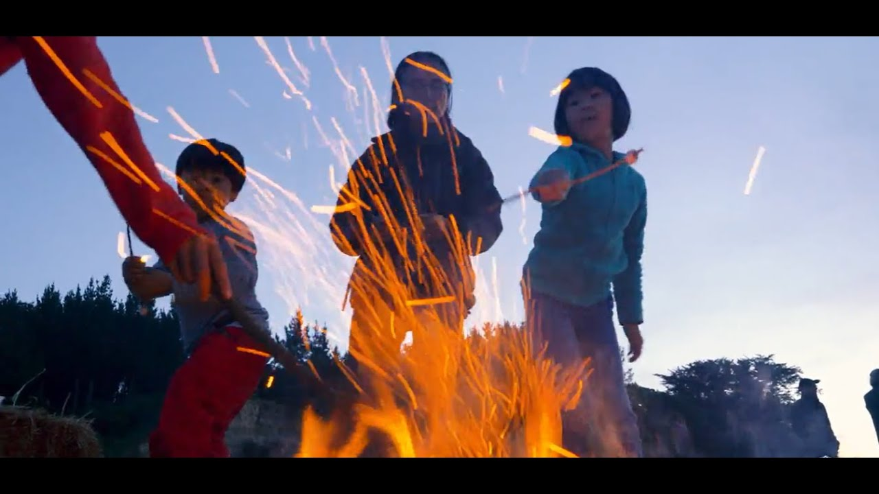 YouTube placeholder shows still from video with children roasting marshmallows over a bonfire at last year's event.