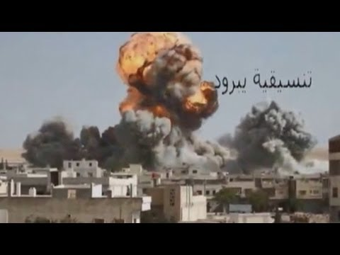 syrian president - Amateur footage has shown the moment a Syrian bomber unleashed a devastating airstrike on a town in the war-torn nation. The film, said to be of the town of ...