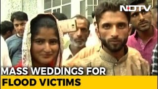 Almost three years after a devastating flood destroyed their lives, poor residents in the Kashmir Valley have finally found a reason to celebrate. In a first of its kind a voluntary organisation has organised weddings for 200 poor couples in the state who were forced to abandon their plans to tie the knot following the floods in 2014. Many of them were rendered homeless after the floods destroyed their homes and left them unemployed.NDTV is one of the leaders in the production and broadcasting of un-biased and comprehensive news and entertainment programmes in India and abroad. NDTV delivers reliable information across all platforms: TV, Internet and Mobile.Subscribe for more videos: https://www.youtube.com/user/ndtv?sub_confirmation=1Like us on Facebook: https://www.facebook.com/ndtvFollow us on Twitter: https://twitter.com/ndtvDownload the NDTV Apps: http://www.ndtv.com/page/appsWatch more videos: http://www.ndtv.com/video?yt