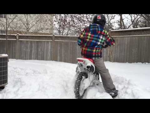 Playing with the CRF110F in a tiny snow covered yard