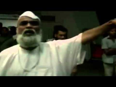 """بالفيديو.. القبض على """"شيخ القذافي"""" متخفياً بين النساء"""